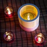 Velas do chá na madeira e no vidro Fotografia de Stock Royalty Free