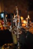 Velas e abóboras de derretimento Fotografia de Stock Royalty Free