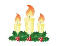 Velas e azevinho do Natal Fotos de Stock Royalty Free