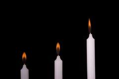 Velas e luz de vela Imagens de Stock