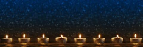 Velas en fondo azul Fotografía de archivo libre de regalías