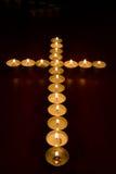 Velas en la forma de una cruz Foto de archivo libre de regalías