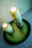 2 velas en la placa Imagen de archivo libre de regalías
