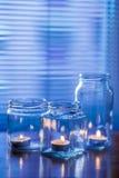 Velas en los tarros de cristal Foto de archivo libre de regalías