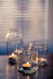 Velas en los tarros de cristal Imágenes de archivo libres de regalías