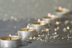 Velas en plata Fotografía de archivo libre de regalías