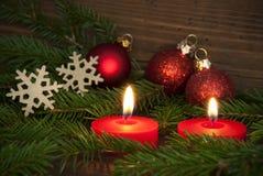 Velas que encienden el fondo Szene de la Navidad Foto de archivo libre de regalías