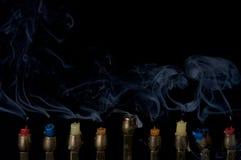 Velas que fuman Imágenes de archivo libres de regalías