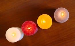 Velas rústicas ardientes Imagen de archivo libre de regalías