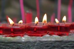 Velas rojas de la cera Fotografía de archivo libre de regalías