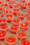 Velas rojas de la forma del loto Imágenes de archivo libres de regalías