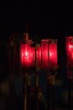 Velas rojas de la iglesia católica Imagen de archivo libre de regalías