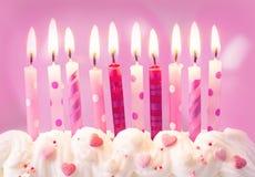 Velas rosadas del cumpleaños foto de archivo libre de regalías
