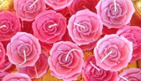 velas rosadas en forma color de rosa Imagen de archivo libre de regalías