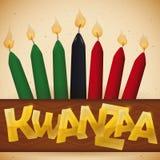 Velas tradicionais sobre uma fita com texto dourado para Kwanzaa, ilustração do vetor ilustração do vetor