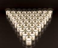 Velas votivas nos suportes de vidro Imagens de Stock
