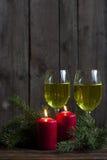 Velas y luces de la Navidad Fotos de archivo
