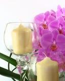 Velas y orquídeas Fotos de archivo libres de regalías