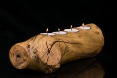 Velas y tenedor de madera Imagenes de archivo
