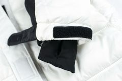 Velcro closure on the sleeve. Of a white jacket royalty free stock image
