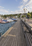 Velden in Austria. People walk along Worthersee lake waterfront with moored boats. It is a market town in state of Carinthia, one of the Austria most popular Royalty Free Stock Image