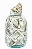 Vele 100 de dollarsbankbiljetten van de V.S. in een glaskruik Royalty-vrije Stock Afbeeldingen