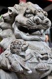 In vele delen van China hebben de steenleeuwen Stock Foto