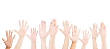 Vele handen omhoog op witte achtergrond stock afbeeldingen