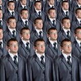 Vele identieke zakenliedenklonen Stock Fotografie