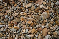 Vele kleine de toonachtergrond van de steen bruine kleur stock foto's
