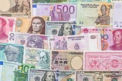 Vele verschillende muntbankbiljetten van wereldland Stock Foto's