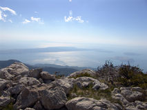 Velebit mountain range in Croatia. Scenic view from the Velebit mountain range looking towards the Adriatic sea in Croatia Royalty Free Stock Photography