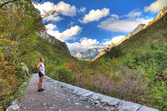 Velebit trail. Beautiful woman hinking a trail in Velebit national park in Croatia. HDR Royalty Free Stock Photography