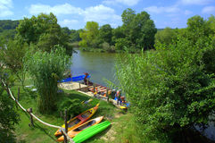 Veleka river boat trips pier. Pier with boats in beautiful green scenery. It is located within natural park Strandja very close to Sinemorets Stock Images
