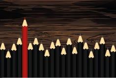 Velen groep zwarte potloden maar rode kleur die van kraai duidelijk uitkomen royalty-vrije illustratie