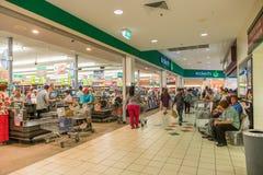 Velen klanten bezige kous vóór Cycloon Debbie kruisen omhoog Stock Afbeelding