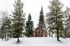 Velena Ev.Lutheran Church in Latvia at winter. A Neogothic style church built of fieldstone Royalty Free Stock Photo