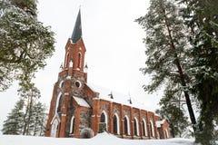 Velena Ev.Lutheran Church in Latvia at winter. A Neogothic style church built of fieldstone Stock Photo