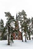 Velena Ev Lutherankyrka i Lettland på vintern Royaltyfri Bild