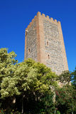 Velez Malaga Castle Tower. View of the Arabic castle tower (Torre del Homenaje) with trees in the foreground, Velez Malaga, Costa del Sol, Malaga Province Stock Images