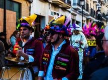VELEZ-MALAGA, SPAIN - FEBRUARY 3, 2018People in costumes celebr. VELEZ-MALAGA, SPAIN - FEBRUARY 3, 2018 People in costumes celebrating carnival in Malaga royalty free stock image