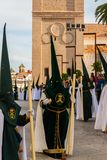 VELEZ-MALAGA, SPAIN - MARCH 29, 2018 People participating in the procession  in the Holy Week in a Spanish city stock photo