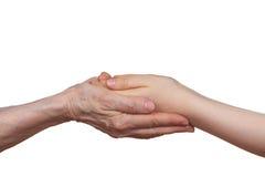 Velho e jovens que guardam as mãos de se Foto de Stock