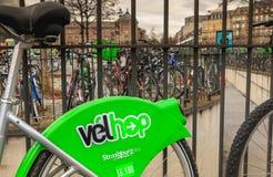 Velhop sharing system bike hanging at a fence stock images
