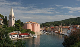 Veli Losinj , Croatia. View on the port and oldest building (romanesque church of st. Nikola) of Veli Losinj - small town on Losinj island. Until 19.century Royalty Free Stock Photos