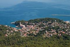 Veli Losinj aerial panorama. Aerial perspective of town Veli losinj in Croatia, Kvarner islands, beautiful blue sea in background, bird perspective view of city Royalty Free Stock Images