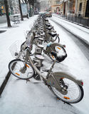 Velib' station after a snow fall in Paris Royalty Free Stock Images