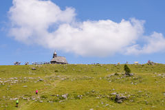 Velika planina plateau, Slovenia, Mountain village in Alps, wooden houses in traditional style, popular hiking Royalty Free Stock Photo