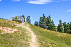 Velika planina plateau, Slovenia, Mountain village in Alps, wooden houses in traditional style, popular hiking. Destination, cattle cows grasing Stock Image
