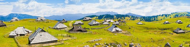 Velika Planina, which in Slovenian means great plateau is one of the most important Slovenian highlands with a particular architec. Ture of wooden huts and barns stock photography